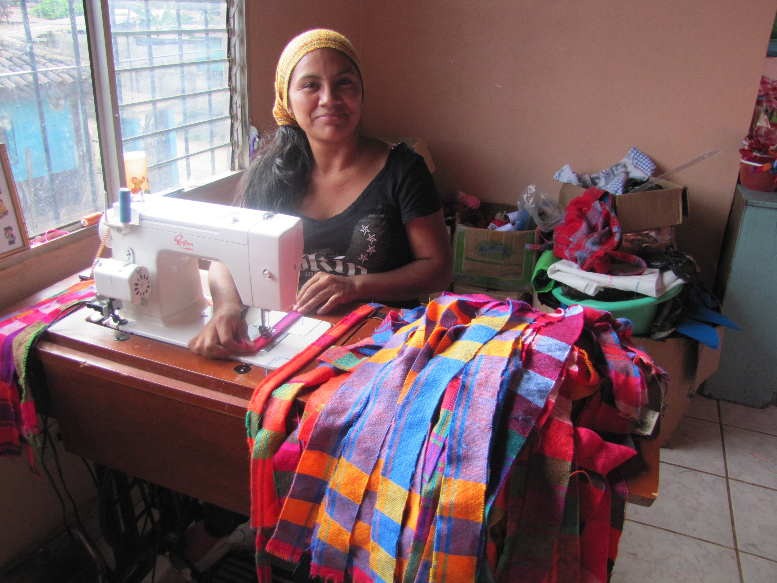 Xiomara, a participant of the programme, is now a businesswoman, mother and community leader