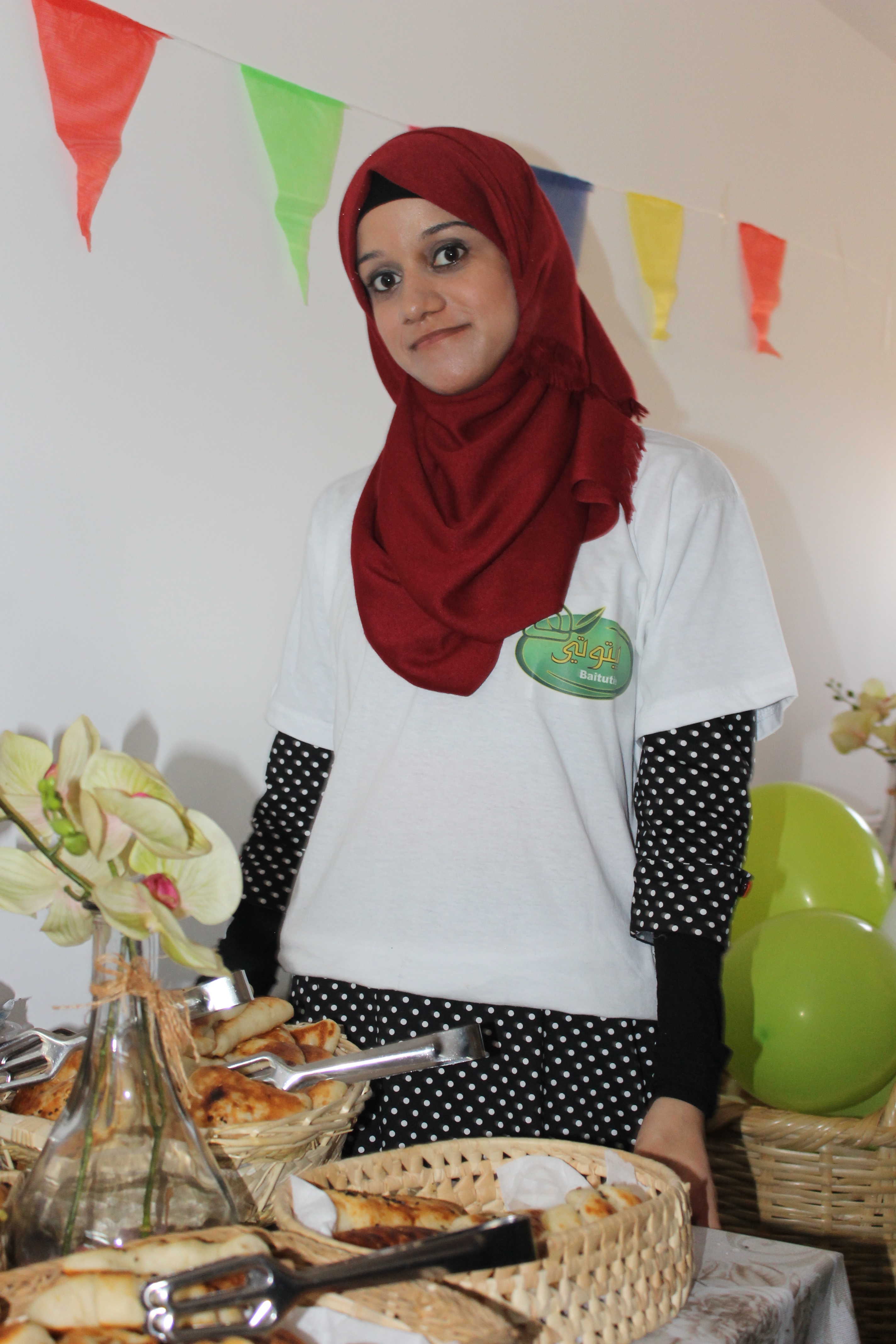 A programme beneficiary showcasing her products