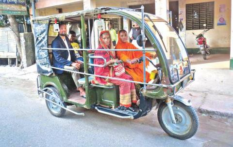 Shapna Rani carries passengers in her auto-rickshaw in Kurigram town recently. Once deserted by her husband, this woman now earns up to Tk 1,000 by running the battery-run rickshaw every day. Photo: Star